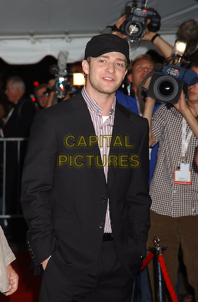 "JUSTIN TIMBERLAKE.Attends the ""Edison"" World Premiere held at Roy Thomson Hall during The Toronto Film Festival,.Toronto 17th September 2005.half length black baseball hat cap suit stubble hands pockets.Ref: ADM/LF.www.capitalpictures.com.sales@capitalpictures.com.© Capital Pictures."
