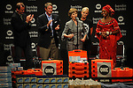 (L-r) Laura Bush takes the microphone as David Lane of the One Campaign, former U.S. Senator Bill Frist, Cindy McCain and Princess Zulu of Zambia applaud at an event for the One Campaign at the Minneapolis Convention Center in Minneapolis, Minnesota on September 2, 2008.