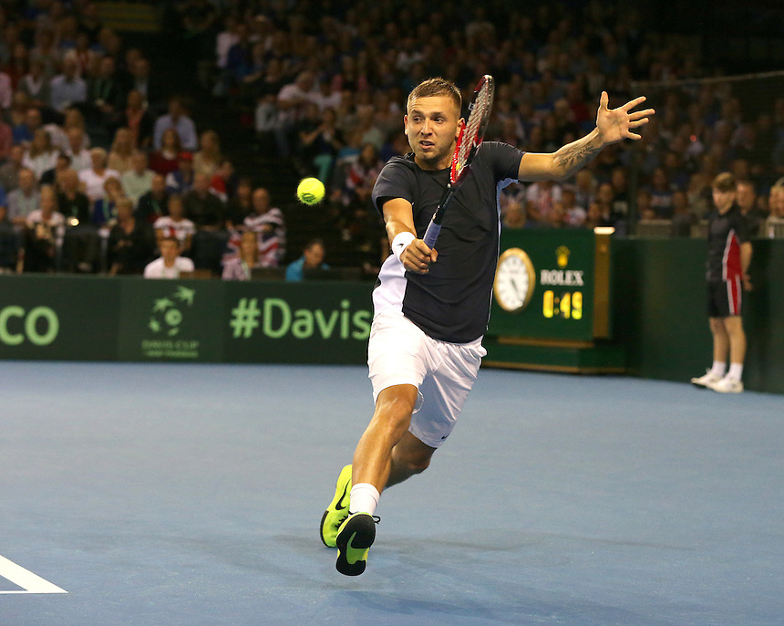 Dan Evans in action during his match against Bernard Tomic<br /> <br /> Photographer Stephen White/CameraSport<br /> <br /> International Tennis - 2015 Davis Cup by BNP Paribas - World Group Semi-Final - Great Britain v Australia - Day 1 - Friday 18th September 2015 - The Emirates Arena - Glasgow<br /> <br /> &copy; CameraSport - 43 Linden Ave. Countesthorpe. Leicester. England. LE8 5PG - Tel: +44 (0) 116 277 4147 - admin@camerasport.com - www.camerasport.com.