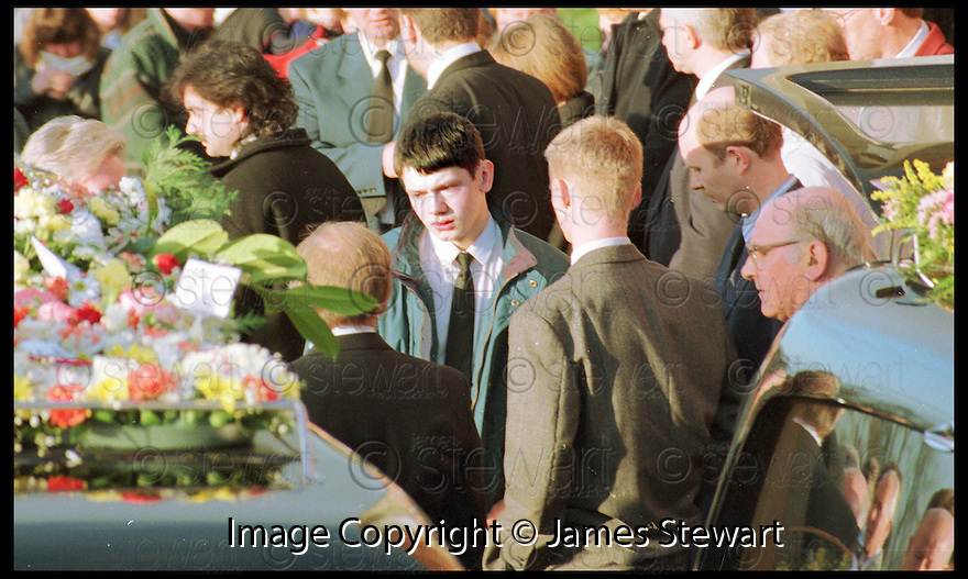 5th November 98   .Copyright Pic : James Stewart   .16th Dec 94 : JAMES GIBSON LOOKS BACK AT THE COFFINS OF HIS TWO FRIENDS WHO DIED AFTER THEIR CAR WENT INTO THE RIVER AT TWECHAR AFTER THE BRIDGE COLLAPSED IN FLOODS.... JAMES GIBSON IS NOW SUING THE POLICE FOR NOT REACTING TO THE DANGERS OF THE COLLAPSED BRIDGE.......Payments to :-.James Stewart Photo Agency, Stewart House, Stewart Road, Falkirk. FK2 7AS      Vat Reg No. 607 6932 25.Office : 01324 630007        Mobile : 0421 416997.E-mail : JSpics@aol.com.If you require further information then contact Jim Stewart on any of the numbers above.........