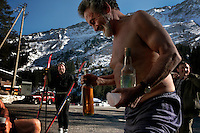 There are also weekend athletes away from their lives and their wives out to have a good time with their homemade grappa.Three half naked Italians along the road of Lucomagno Pass drink after cross country skiing.<br />    They do this every Wednesday without their wives.  Drinking home made Grappa and  Barbera wine and home made liquor made with roots..Glacier Express train between Sedrun and Andermatt...Figure 8 curve with tunnels is above San Gotthard tunnel... between Andermatt and Alidorf.
