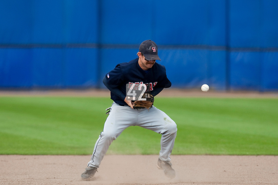 14 September 2009: Third base Christopher Falls of Great Britain fails to catch the ball during the 2009 Baseball World Cup Group F second round match game won 15-5 by South Korea over Great Britain, in the Dutch city of Amsterdan, Netherlands.