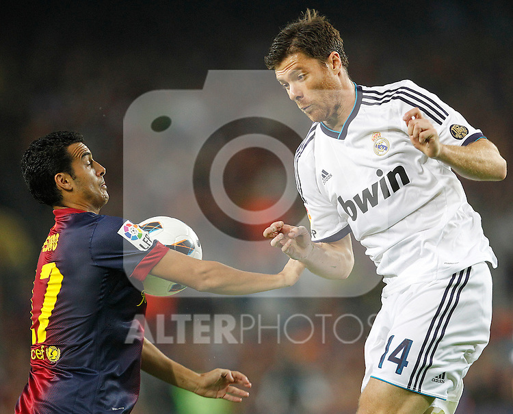 Barcelona's Pedro Rodriguez and Real Madrid's Sergio Ramos during la Liga match on october 7th 2012. ..Photo: Cesar Cebola  / ALFAQUI