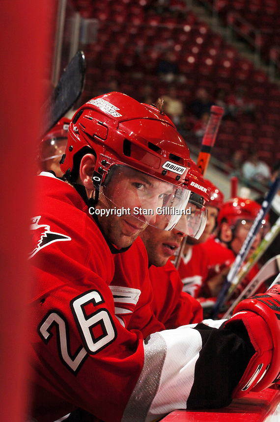 Carolina Hurricanes' Erik Cole watches from the bench during their game with the Tampa Bay Lightning Thursday, Sep. 22, 2005 in Raleigh, NC. Carolina won 5-2.