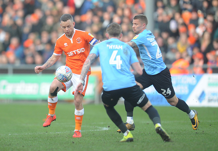 Blackpool's Jay Spearing under pressure from Southend United's Jason Demetriou<br /> <br /> Photographer Kevin Barnes/CameraSport<br /> <br /> The EFL Sky Bet League One - Blackpool v Southend United - Saturday 9th March 2019 - Bloomfield Road - Blackpool<br /> <br /> World Copyright © 2019 CameraSport. All rights reserved. 43 Linden Ave. Countesthorpe. Leicester. England. LE8 5PG - Tel: +44 (0) 116 277 4147 - admin@camerasport.com - www.camerasport.com