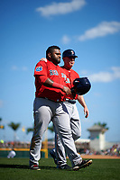 Boston Red Sox Pablo Sandoval (48) and third base coach Brian Butterfield (55) walk off the field in between innings during a Spring Training game against the Pittsburgh Pirates on March 9, 2016 at McKechnie Field in Bradenton, Florida.  Boston defeated Pittsburgh 6-2.  (Mike Janes/Four Seam Images)