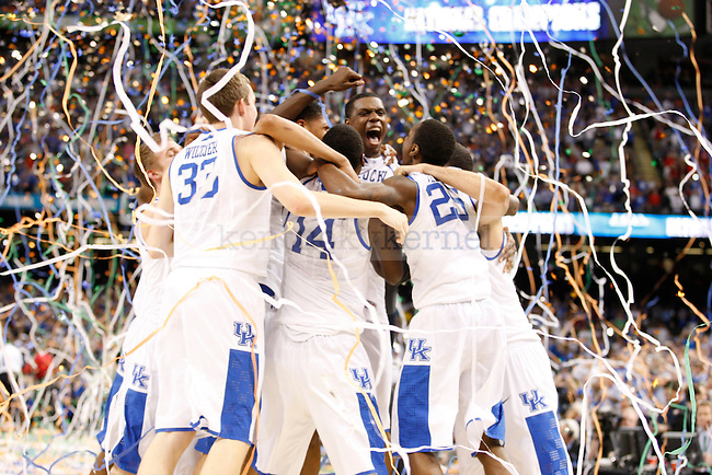 UK teammates celebrate after winning the championship game of the NCAA Tournament between the University of Kentucky and Kansas University, in the Superdome, on Monday, April 2, 2012 in New Orleans, La. Kentucky won 67-59 Photo by Latara Appleby | Staff