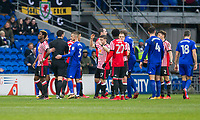 Didier Ndong of Sunderland (far left) reacts after being shown a red card during the Sky Bet Championship match between Cardiff City and Sunderland at the Cardiff City Stadium, Cardiff, Wales on 13 January 2018. Photo by Mark  Hawkins / PRiME Media Images.