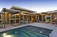 Swimming pool is seen at mid-century architecture home