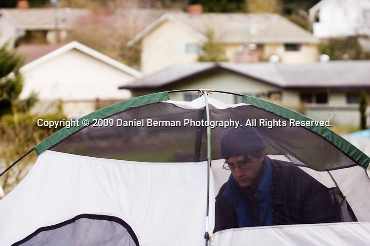 A Tent City 3 resident who declined to provide their name packs up their belongings on moving day at Calvin Presbyterian Church February 28, 2009 in Shoreline, WA. After three months in Shoreline, Tent City 3 will be making a new home at Saint Mark's Cathedral near downtown Seattle.