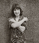 Vintage black and white print scan. File #79-151-#8. Cathleen Wild looking anxious. 1979