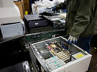 12/4/2008 3:01:43 PM -- Seattle, WA.Computers are loaded on a conveyer by a Total Reclaim Inc., Environmental Services employee in Seattle Thursday Dec. 4, 2008..