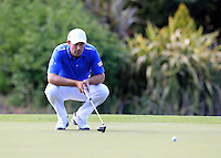 Padraig Harrington (IRL) lines up his putt on the 18th green during Friday's Round 2 of the 2014 Irish Open held at Fota Island Resort, Cork, Ireland. 20th June 2014.<br /> Picture: Eoin Clarke www.golffile.ie