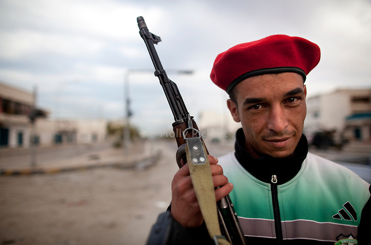 A revolutionary fighter from Al-Bayda in Eastern Libya poses for a photograph in Sirte, Libya, the day after Col. Muammar Gaddafi was captured and killed, Oct. 21, 2011.