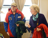 CROYDON PA - DECEMBER 27: Joe Hunter (L) and Lynne Plunkett of Croydon, Pennsylvania carry winter coats they received at a Christmas luncheon and coat give away for people in need December 27, 2014 at Father Crehan Hall in Croydon, Pennsylvania. (Photo by William Thomas Cain/Cain Images)