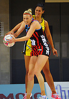 Demelza Fellowes intercepts a pass to Ameliaranne Wells during the ANZ Netball Championship match between the Central Pulse and Mainland Tactix at Te Rauparaha Arena, Wellington, New Zealand on Saturday, 11 May 2015. Photo: Dave Lintott / lintottphoto.co.nz