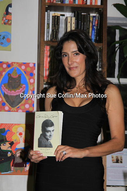 """Another World's Alicia Coppola speaks and signs her book """"Gracefully Gone"""" - a fusion of two journals: her father Matthew L. Coppola Sr. and hers - on August 23, 2013 at Book Revue, Huntington, New York. (Photo by Sue Coflin/Max Photos)"""