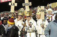 06 December 2009:  Three Saints fans dressed as Saints / Popes /Bishops hold a sign that says 'La-Brees-iana'..The New Orleans Saints defeated the Washington Redskins  33-30 in Overtime to improve to 12-0 on the season at FedEx Field in Landover, MD.