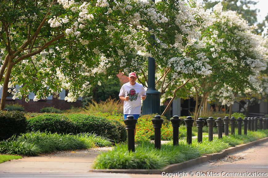 A jogger runs on campus. Photo by Thomas Graning/Ole Miss Communications