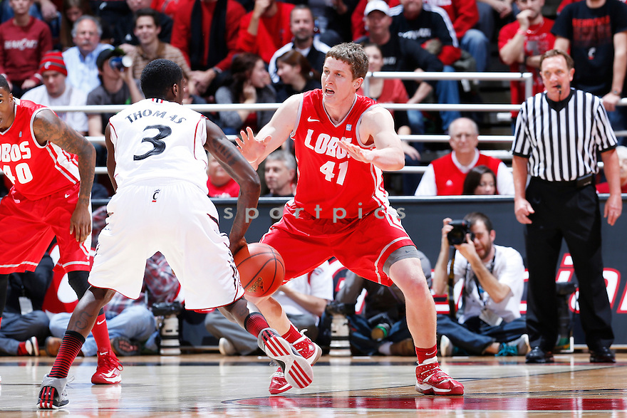 CINCINNATI, OH - DECEMBER 27: Cameron Bairstow #41 of the New Mexico Lobos defends against the Cincinnati Bearcats during the game at Fifth Third Arena on December 27, 2012 in Cincinnati, Ohio. New Mexico won 55-54. Cameron Bairstow