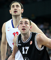 28.03.2012 Bilbao, Spain. Euroleague Playoff game 3. Picture show  Axel Hervelle (F) and Nenad Krstic (R) in action  during match betwen Gescrap BB againts CSKA Moscow at Bilbao Arena