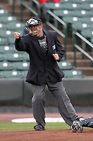 Home plate umpire Craig Barron makes a call during a game between the Rochester Red Wings and Lehigh Valley IronPigs at Frontier Field on April 22, 2012 in Rochester, New York.  Rochester defeated Lehigh Valley 3-2.  (Mike Janes/Four Seam Images)