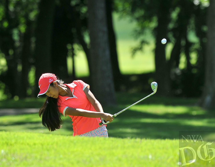 NWA Media/Michael Woods --06/24/2014-- w @NWAMICHAELW...Elizabeth Moon from Forrest City  chips off the 10th fairway Tuesday morning during the last round of the ASGA Stroke Play tournament at Shadow Valley Country Club in Rogers.