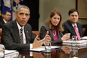 United States President Barack Obama (C) delivers remarks to reporters before meeting with Health and Human Services Secretary Sylvia Matthews Burwell, Ebola response coordinator Ron Klain and other members of the president's national security and public health teams to receive an update on the government's Ebola response in the Roosevelt Room at the White House December 12, 2014 in Washington, DC. Obama said that important progress had been made on the fight against Ebola in West Africa but that work would continue until the virus is stamped out. <br /> Credit: Chip Somodevilla / Pool via CNP