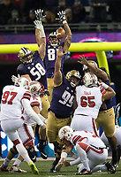 The Huskies try to block a field goal right before halftime.