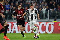 Calcio, Serie A: Juventus vs Milan. Torino, Juventus Stadium, 10 marzo 2017.<br /> Juventus' Marko Pjaca, right, is chased by AC Milan's Jose' Sosa during their Italian Serie A football match at Turin's Juventus Stadium, <br /> UPDATE IMAGES PRESS/Manuela Viganti