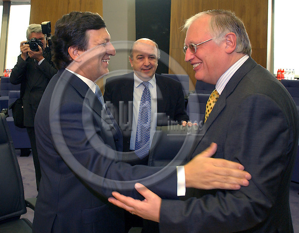 Brussels-Belgium - November 24, 2004---The Euroepan Commission meets for the first time on its regular-weekly cycle at its refurbished Headquarters 'Berlaymont'; here, the President of the EC, Jose (José) Manuel BARROSO (le) from Portugal with the European Commissioner Joaquin (Joaquín) ALMUNIA (ce) from Spain, in charge of Economic and Monetary Affairs, and Guenter (Günter VERHEUGEN) (ri) from Germany, Vice-President of the EC and in charge of Enterprise and Industry---Photo: Horst Wagner/eup-images