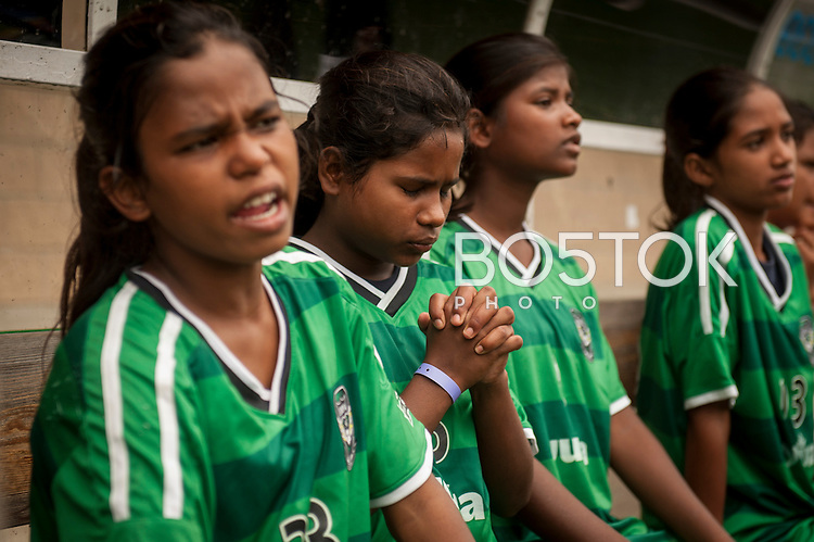 Yuwa team players full of sadness, as they are loosing, watching the football game against Santa Teresa team.  Hernani (Basque Country) 04 July 2013. Yuwa Jharkhand is a program for girls aged 5-17 to promote health, education and improved livelihoods through football. Yuwa team was in Donostia playing Donosti Cup international football tournament (Gari Garaialde/Bostok Photo)