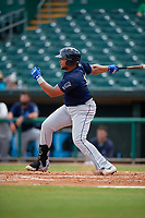 Mobile BayBears Jhoan Urena (14) hits a single during a Southern League game against the Montgomery Biscuits on May 2, 2019 at Riverwalk Stadium in Montgomery, Alabama.  Mobile defeated Montgomery 3-1.  (Mike Janes/Four Seam Images)