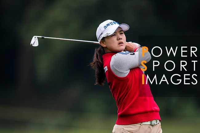 Yoo-Lim Choi of Korea in action during the Hyundai China Ladies Open 2014 on December 12 2014 at Mission Hills Shenzhen, in Shenzhen, China. Photo by Li Man Yuen / Power Sport Images