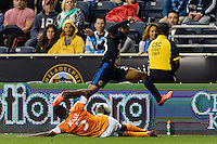 Raymon Gaddis (28) of the Philadelphia Union jumps over the tackle of Warren Creavalle (5) of the Houston Dynamo during a Major League Soccer (MLS) match at PPL Park in Chester, PA, on September 14, 2013.