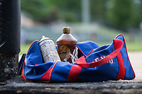 A bottle of pine tar and a can of tuf-skin sit in a Texas Rangers team bag outside the Hickory Crawdads dugout prior to the game against the Kannapolis Intimidators at Kannapolis Intimidators Stadium on April 22, 2017 in Kannapolis, North Carolina.  The Intimidators defeated the Crawdads 10-9 in 12 innings.  (Brian Westerholt/Four Seam Images)