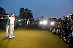 AUGUSTA, GA - APRIL 14: Adam Scott of Australia is presented the winner's traditional green jacket by pervious years' winner Bubba Watson after Scott's 74th hole playoff victory against Angel Cabrera of Argentina during the Final Round of the 2013 Masters Golf Tournament at Augusta National Golf Club on April 14, 2013 in Augusta, Georgia. Adam Scott became the first Australian ever to win the famed Masters Golf Tournament , one of the four major championships, in it's 79 year history.
