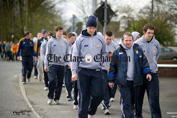 Davy Fitzgerald, Clare senior hurling manager, leads members of Clare GAA along the Tulla Road at the start of the Clare GAA 12k Charity Walk to raise money for county teams. Photograph by Declan Monaghan
