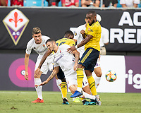 CHARLOTTE, NC - JULY 20: Alexandre Lacazette #9 and Valentin Eysseric #7 contest the ball during a game between ACF Fiorentina and Arsenal at Bank of America Stadium on July 20, 2019 in Charlotte, North Carolina.