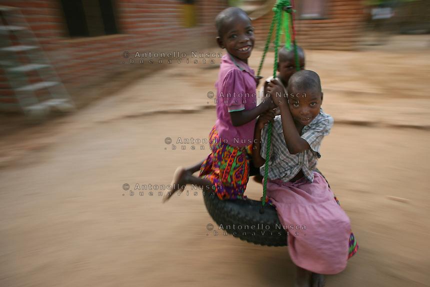 Children play at the Tiyamike Mulungu Center orphanage in Bangula,Malawi.