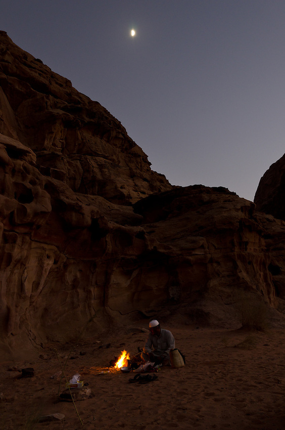 A bedouin guide starts a cooking fire in Wadi Rum, Jordan. many Bedouins have left their lives as herders and turned to tourism for their livelihoods.