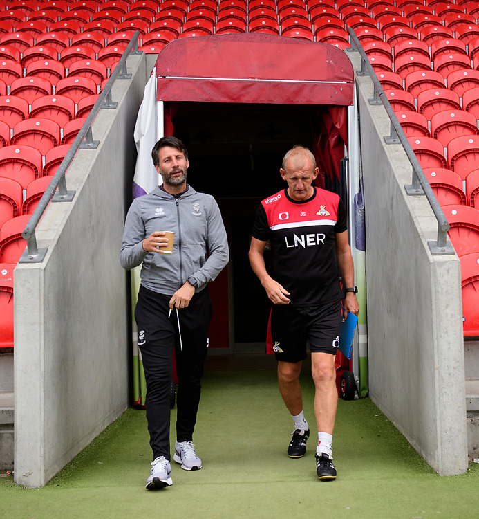 Lincoln City manager Danny Cowley, left, and Doncaster Rovers development manager John Schofield walk out of the tunnel together<br /> <br /> Photographer Chris Vaughan/CameraSport<br /> <br /> EFL Leasing.com Trophy - Northern Section - Group H - Doncaster Rovers v Lincoln City - Tuesday 3rd September 2019 - Keepmoat Stadium - Doncaster<br />  <br /> World Copyright © 2018 CameraSport. All rights reserved. 43 Linden Ave. Countesthorpe. Leicester. England. LE8 5PG - Tel: +44 (0) 116 277 4147 - admin@camerasport.com - www.camerasport.com