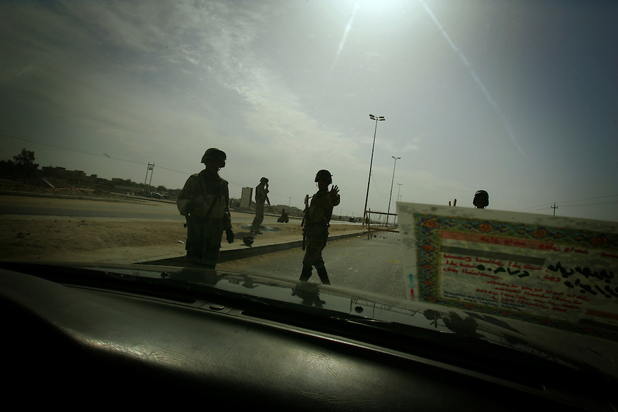 Police and soldiers and security men prowl the streets of Najaf, Iraq during the January 2005 election period.