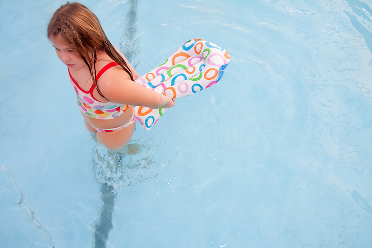 Little Girl playing in a swimming pool