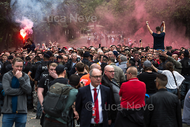 Stewards and staff from Liverpool Football Club.<br /> <br /> Villa Borghese.<br /> <br /> Rome, 02/05/2018. Following and documenting a group of Liverpool F.C. supporters chanting and cheering on throughout the streets of central Rome while waiting for the Champions League Semi-final (second leg) at the Stadio Olimpico versus A.S. Roma. The supporters were escorted by heavy presence of the Italian Police and Carabinieri, assisted by Merseyside Police's officers (British Police) and by the stewards and staff from Liverpool Football Club. Last week, during the first leg of the semi-final in Liverpool, an English fan was attacked by Italian supporters outside Anfield stadium. However, the day of the match in Rome passed without any serious incidents involving supporters and just one arrest - a Liverpool supporter - was made (on suspicion of common assault and a public order offence). The actual match was played in the evening and saw Liverpool losing 4-2 but due to the aggregate with the first match, 7-6, the &quot;Reds&quot; conquered the access to the Champions League final in Kiev against Real Madrid. A statement from the English club read: &quot;Liverpool would like to thank all supporters who travelled to Rome for Wednesday evening's Champions League meeting with Roma at Stadio Olimpico for their exemplary conduct. Over 5,000 fans made the journey to the Italian capital for yesterday's semi-final second leg, behaving impeccably throughout, with no major incidents reported. LFC also acknowledges the significant resources deployed by Roma, UEFA, Merseyside police, Italian police and security services in Rome to ensure all fans enjoyed a safe visit.&quot;<br /> <br /> For more info about the football teams please click here: http://www.asroma.com/en &amp; http://www.liverpoolfc.com/