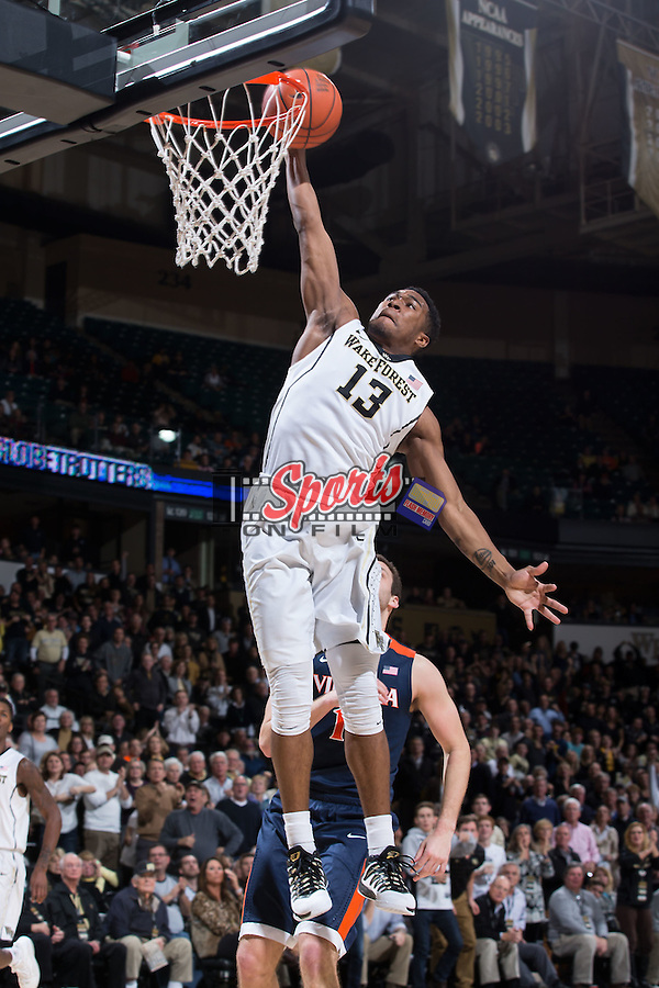 Bryant Crawford (13) of the Wake Forest Demon Deacons skies for a slam dunk during second half action against the Virginia Cavaliers at the LJVM Coliseum on January 26, 2016 in Winston-Salem, North Carolina.  The Cavaliers defeated the Demon Deacons 72-71.   (Brian Westerholt/Sports On Film)