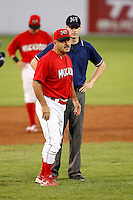 August 12, 2009:  Manager Mark DeJohn of the Batavia Muckdogs argues a call with base umpire Joe Muenzer during a game at Dwyer Stadium in Batavia, NY.  The Muckdogs are the Short-Season Class-A affiliate of the St. Louis Cardinals.  Photo By Mike Janes/Four Seam Images