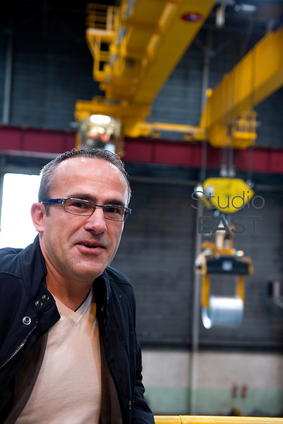 Renault's lifting manager Daniel Durieux poses for a photograph in Renault's Sandouville workshops, near Le Havre, Normandy region, France, on November 24, 2011. Photo by Lucas Schifres/Pictobank