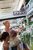 FRENCH POLYNESIA, Tahiti. Laurel and Fiona shopping for vegetables at the Papeete Municipal Market.