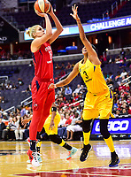 Washington, DC - June 15, 2018: Washington Mystics guard Elena Delle Donne (11) shoots a shot over Los Angeles Sparks forward Candace Parker (3) during game between the Washington Mystics and Los Angeles Sparks at the Capital One Arena in Washington, DC. (Photo by Phil Peters/Media Images International)